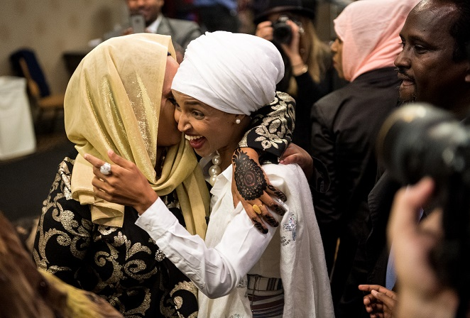 greeted supporter as she arrived at her victory party Tuesday night at the Courtyard Marriott Downtown. ] (AARON LAVINSKY/STAR TRIBUNE) aaron.lavinsky@startribune.com Minneapolis community activist Ilhan Omar won a historic election, becoming the nations first Somali-American elected to a statehouse. Her election night watch party was held Tuesday, Nov. 8, 2016 at the Courtyard Minneapolis Downtown.